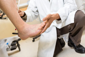 Podiatrist Checking Achilles Tendon